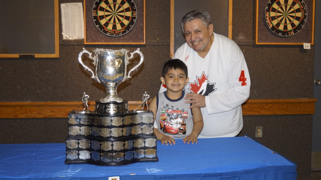 Memorial Cup on display at Sarnia Legion. (Left to right) Mark George Jr. and his dad, Mark A. George Sr., have their photo taken with the cup. May 18, 2017 (Photo by Melanie Irwin)