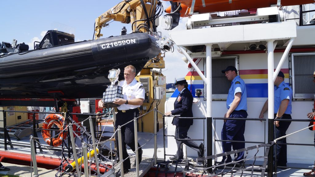 The Memorial Cup is loaded on the Canadian Coast Guard Ship Constable Carriere to travel to the Memorial Cup host city of Windsor.  May 18, 2017 (Photo by Melanie Irwin)