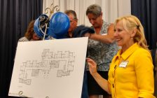Hospice of Windsor and Essex County board chairperson Veronique Mandal helps reveal plans for the expansion of Hospice's Windsor residential complex during its tenth anniversary celebration on May 17, 2017.  (Photo by Mark Brown/Blackburn News)