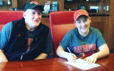 Sydney Caron Signs Commitment Papers With Davenport University Head Coach Kurt Carter (Photo courtesy of Sydney Caron)