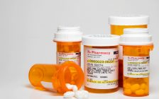 Prescription pills in plastic medicine bottles. (© Can Stock Photo / piedmont_photo)