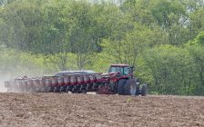 Farm tractor planting seeds in a field. (Photo courtesy of © Can Stock Photo / chas53)
