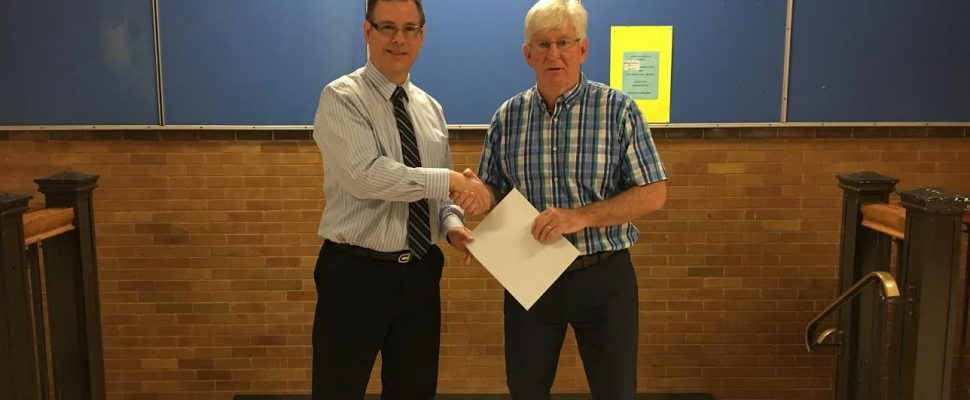 Foundation Board member, Scott McKelvie, makes a cheque presentation to GLSS principal, Paul Wiersma. (Photo submitted by Great Lakes Secondary School)