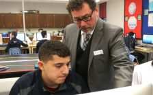 Rocky Ieraci working with one of his students at Holy Names Catholic High School in Windsor. (Photo courtesy of Stephen Fields/Windsor-Essex Catholic District School Board)