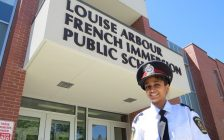 11-year-old Chinmayi Manda, London's police chief of the day, standing outside of Louise Arbour French Immersion, May 15, 2017. (Photo by Miranda Chant, Blackburn News.)