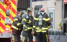 Firefighters at the scene of an apartment fire at the corner of Wyandotte St. E and Gladstone Ave. in Windsor, May 20, 2017. (Photo by Adelle Loiselle)