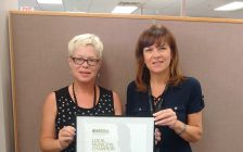 Chantal Perry, Program Manager with ESS and Valerie Colasanti, Chatham-Kent Director of Employment and Social Services, are seen with the Ontario Municipal Social Services Local Municipal Champion award. June 22, 2017. (Photo courtesy of Municipality of Chatham-Kent)