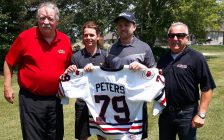 Tyler Peters with  his number 79 sweater, which will be retired by the Sarnia Legionnaires. (photo by Josh Boyce)