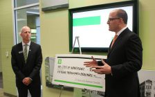 Windsor Mayor Drew Dilkens (right) receives a cheque for $15,000 from the TD Bank on Ouellette Ave. in Windsor, June 15, 2017. (Photo by Mike Vlasveld)