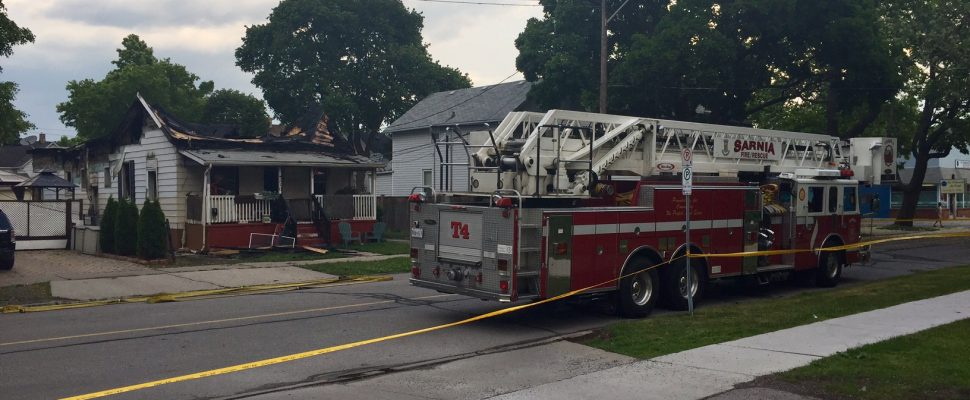 Fire crews are parked outside a fire-damaged home on Davis St in Sarnia on June 17, 2017 (Photo by Melanie Irwin/Blackburn News)