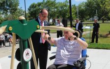 Windsor Mayor Drew Dilkens (left) watches Huron Lodge Residents Council Vice President Oskar Rauscher (right) use new exercise equipment outside of the long-term care home, June 21, 2017. (Photo by Mike Vlasveld)