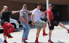 "Men dancing at ""Walk a Mile in Her Shoes"" event. June 3, 2017. (Photo courtesy of Sarah Cowan, Blackburn News Chatham-Kent)"