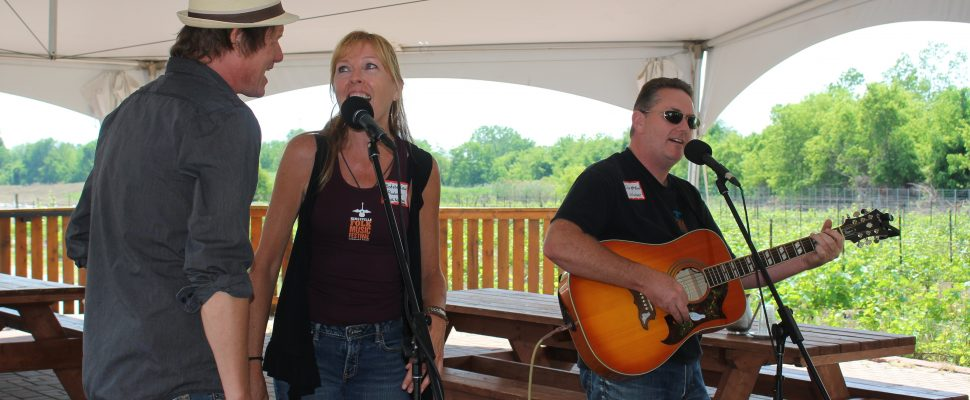 John and Michele Law, producers of the Kingsville Folk Music Festival and singer Glen MacNeil at the media launch for the event, June 14, 2017. (Photo by Maureen Revait)