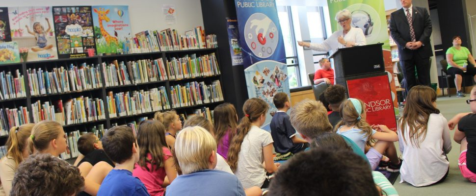 Windsor Public Library CEO Kitty Pope speaks to a group of elementary school students at the branch on Seminole St., June 19, 2017. (Photo by Mike Vlasveld)