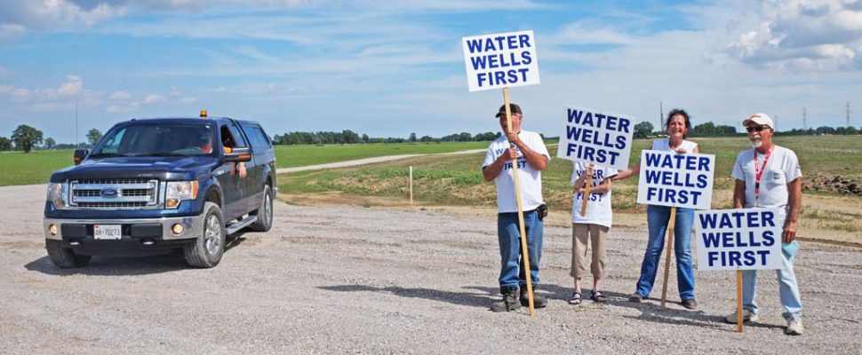 Water Wells First protesters stand at a wind turbine construction site north of Chatham. (Photo courtesy of Water Wells First)