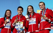Team Canada swimmers Kylie Masse (from left), Richard Funk, Peggy Oleksiak and Yuri Kisil celebrate their bronze medals at the FINA World Championships in Hungary on July 26, 2017 (Photo courtesy Swimming Canada/Twitter)