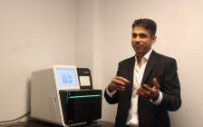 Dr. Raj Atikkuke explaining the equipment used for genome profiling at ITOS Oncology, July 5, 2017. (Photo by Maureen Revait)