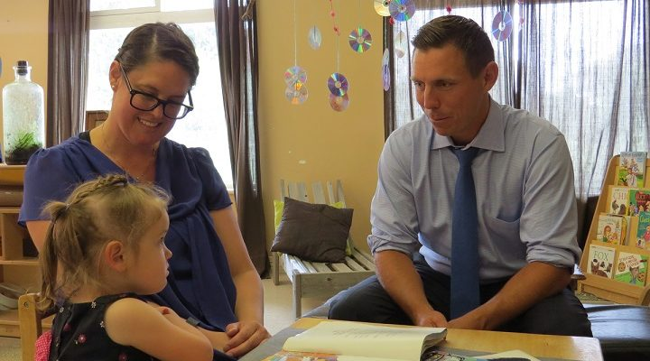 Ontario PC Leader Patrick Brown reads a story to 3-year-old Zoe Wilson and her mother Tanya at the St. Thomas Early Learning Centre, July 11, 2017. (Photo by Miranda Chant, Blackburn News.)
