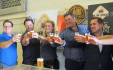 The Factory GM Dan Cassidy, Silverstacks Owners Matt and Kristen Buckley, and E. & E. McLaughlin's Paul McLaughlin and Kris Dinel toast the new developement of the former Kellogg plant, August 16, 2017. (Photo by Miranda Chant, Blackburn News)