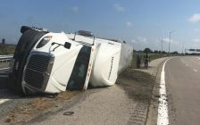 The scene after a transport truck rolled over on an on-ramp to the Hwy. 401 near Tilbury. August 30, 2016. (Photo courtesy of Essex County OPP)