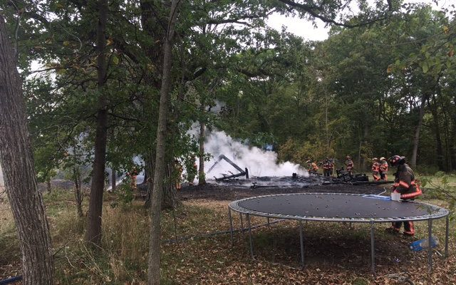 Firefighters extinguish a blaze along the 4th Concession in Essex, September 28, 2017. (Photo courtesy of Essex Fire and Rescue Services via Twitter)