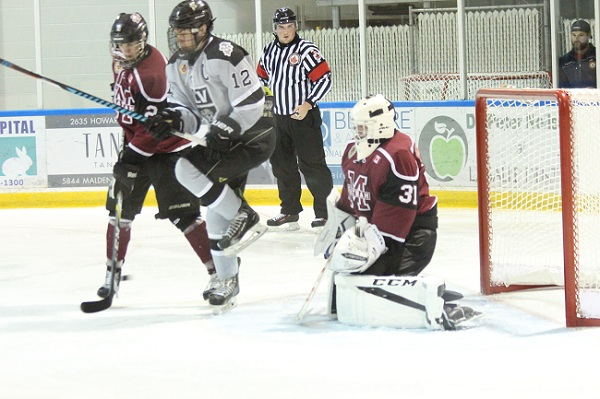 LaSalle Vipers captain Eric Kirby attempts to get out of the way of a shot in front of Chatham Maroons goaltender Ryan Wagner. September 20, 2017. (Photo courtesy of Garrett Fodor)