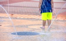 Child playing in spray pad. Photo courtesy of © Can Stock Photo / liveslow