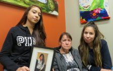 Cindy Gladue's daughter Cheyanne, mother Donna, and daughter Brandy hold a photo of the murdered Edmonton woman, October 20, 2017. (Photo by Miranda Chant, Blackburn News)