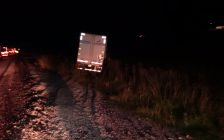 Chatham-Kent OPP say a transport truck went off the road on the WB Hwy. 401 near Merlin Rd. on October 18, 2017. (Photo courtesy of Chatham-Kent OPP)