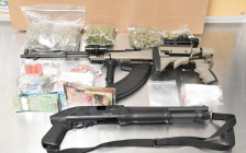 A semi-automatic rifle, 12 gauge shotgun, drugs and cash seized from a home on Limberlost Rd., October 18, 2017. Photo courtesy of London police.