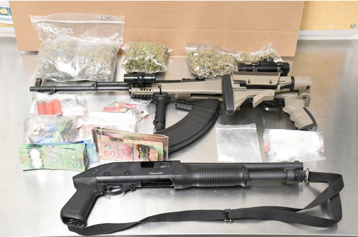 Fire Leads Police To Guns, Drugs