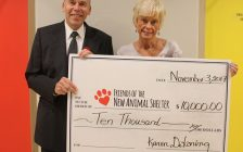 Dr. Bruce Warwick with the Friends of the New Animal Shelter accepts a cheque from Karen DeKoning. November 3, 2017. (Submitted photo)