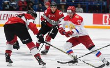 Two Team OHL Players battle a Team Russia player for the puck during Game 4 of the Canada Russia Series in Sudbury.