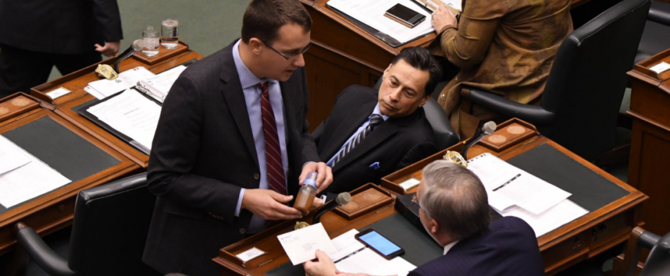 Lambton-Kent-Middlesex MPP Monte McNaughton delivers dirty well water to Environment Minister Chris Ballard. November 21, 2017 (Submitted photo.)