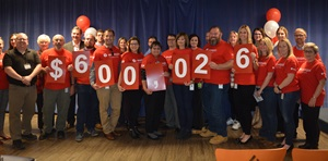 Union Gas employees in Chatham-Kent unveil their fundraising totals for the local United Way. November 27, 2017. (Photo courtesy of Union Gas)