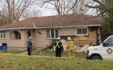 Fire officials investigate the cause of an explosion at a home at 1335 Hamilton Rd., December 5, 2017. (Photo by Miranda Chant, Blackburn News)