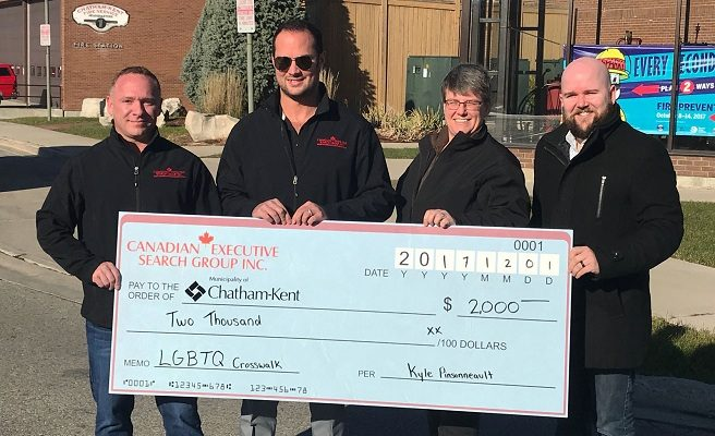 Cheque presentation towards the rainbow crosswalk in Chatham. December 1, 2017. (Photo courtesy of the Municipality of Chatham-Kent).
