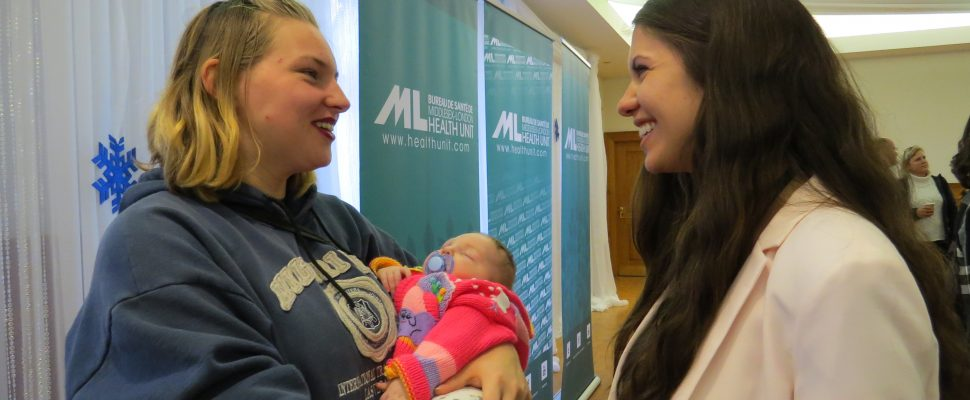 Emily Berryhill and her three-month-old daughter Octavia visit with public health nurse Becki Bohdanowicz at the Middlesex London Health Unit, December 1, 2017. (Photo by Miranda Chant, Blackburn News)