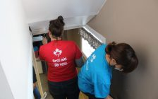 Habitat for Humanity volunteers work to fix up the Matthew House refugee Welcome Centre, December 12, 2017. (Photo by Maureen Revait)