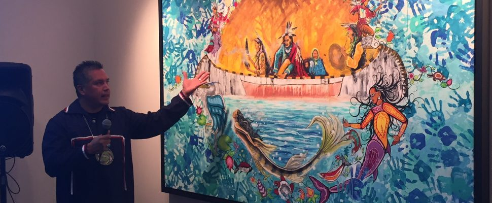 "Aamjiwnaang artist John Williams unveils his painting titled ""Mookibii"" at the Maawn Doosh Gumig, Aamjiwnaang First Nation Community Centre. December 1, 2017 (Photo by Melanie Irwin)"