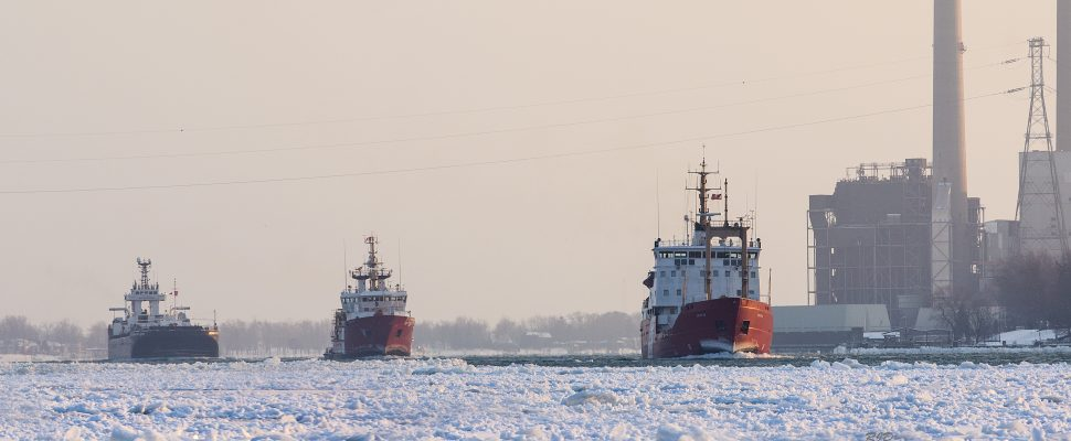 The Canadian Coast Guard Ships Samuel Risley and Griffon escort a commercial ship through heavy ice on the St. Clair River Jan 15 2015. Photo credit: Richard Dompierre. (Used with permission.)