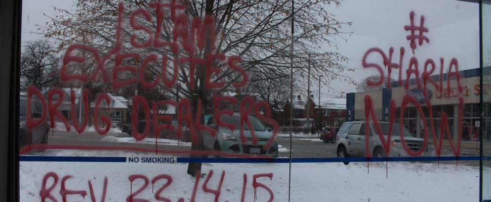 Vandalism on a bus shelter on Ouellette Ave. near Giles Blvd., shelters along Ouellette Ave between Wyandotte St. and Tecumseh Rd. hit with similar messages, December 13, 2017. (Photo by Maureen Revait)