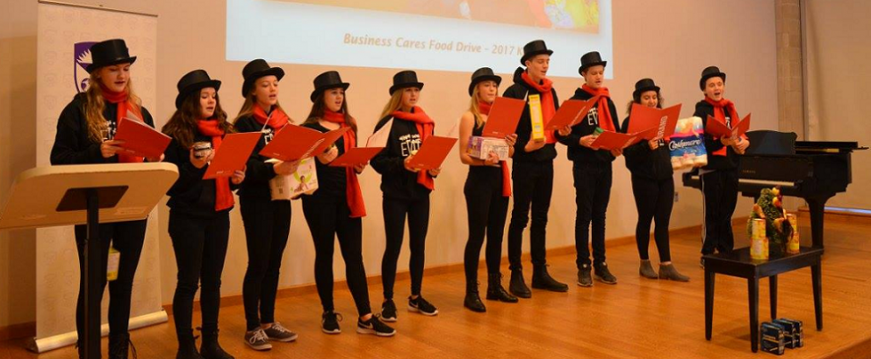 Students from The Grand Theatre's High School Project production of Evita help launch the 2017 Business Cares Food Drive, December 1, 2017. Photo by Jason Menard.