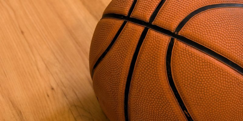 Basketball on a wooden floor close up. © Can Stock Photo / johnnychaos
