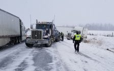 OPP officer at the scene of a tractor trailer collision on Hwy. 402 at Centre Rd. January 30, 2018. Photo courtesy of the OPP.