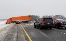 A jack-knifed tractor trailer blocks the westbound 402 near Strathroy. File photo courtesy of the OPP.