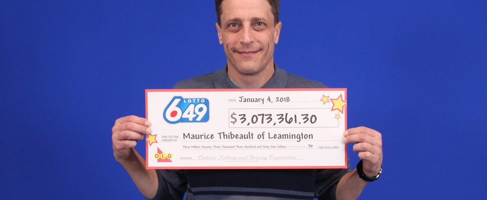 Maurice Thibeault picks up cheque. January 5, 2018. (Photo courtesy of OLG)