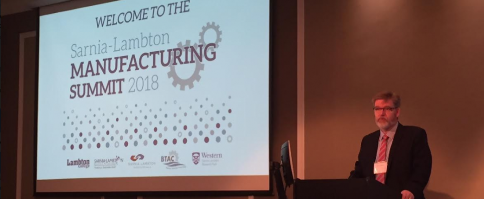 Bluewater Technology Access Centre Project Manager/Research Engineer Rick Williston welcomes people to the 2018 Sarnia-Lambton Manufacturing Summit. January 25, 2018 (Photo by Melanie Irwin)