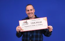 Raymond De Ridder shows off his prize from a recent win on a POOLS card he bought in Chatham. (Photo courtesy of OLG)