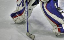 Close-up of a goaltender in a defensive position. © Can Stock Photo / dbriyul